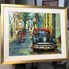 How about this bright and jazzy painting from Cuba? Its liquid light is contained by a standard white linen liner and a gold frame that has been hand-rubbed to let the red bole show through from beneath.